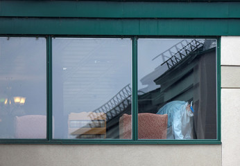 A person seen cleaning from a window at a senior's long-term care facility in Montreal