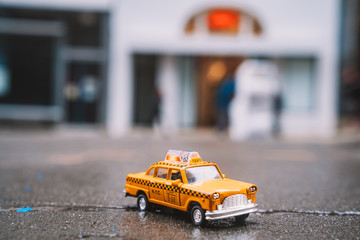 Wall Mural - Model taxi car is parked on the Broadway near Casey Neistat's Three Six Eight studio