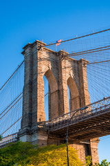 Wall Mural - Brooklyn Bridge over East River viewed from New York City Lower Manhattan waterfront in the morning.