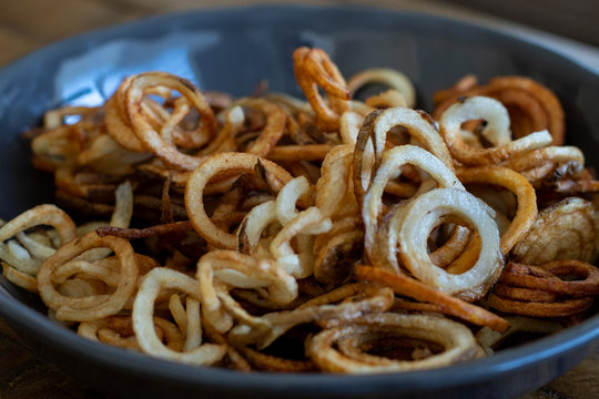 healthy golden brown curly fries in a bowl