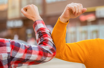 Elbow bump. Bump elbows. Friends shaking elbows outdoors. Elbow greeting style. Coronavirus epidemic. Coronavirus, illness, infection, quarantine, COVID-19. Don't shake hands. Stop handshakes Fotomurales