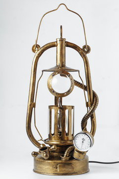 fantastic product in steampunk style, table lamp with from a kerosene lamp with additional valves on a white background