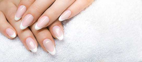 Foto op Plexiglas Manicure Manicure and Hands Spa. Beautiful Woman hands closeup. Manicured nails and Soft hand skin wide banner.