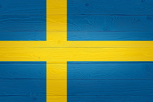 Sweeden flag painted on old wood plank background. Brushed natural light knotted wooden board texture. Wooden texture background flag of Sweeden.