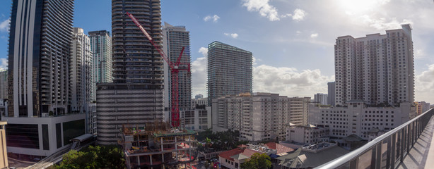 Wall Mural - Cityscape skyline construction in Brickell neighborhood of Miami, Florida showing Hotels and apartments.