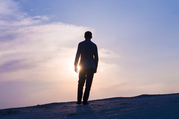 silhouette photo of guy at sunset time on sky background