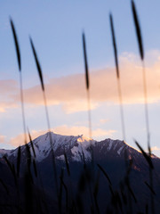 Close-up Of Snowcapped Mountains Against Sky During Sunset