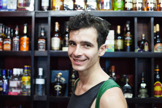 Portrait Of Smiling Young Man In Liquor Store