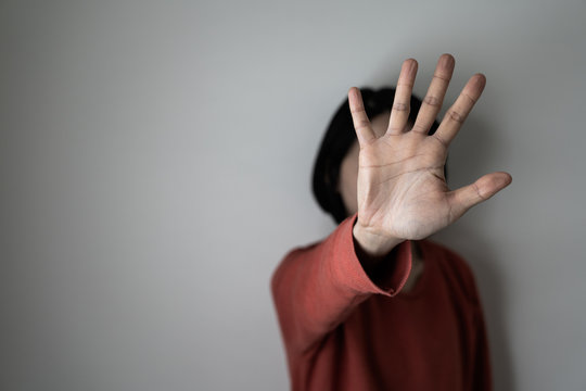 Young woman showing her denial, or saying NO with her hand