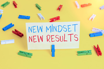 Word writing text New Mindset New Results. Business photo showcasing obstacles are opportunities to reach achievement Colored clothespin papers empty reminder yellow floor background office