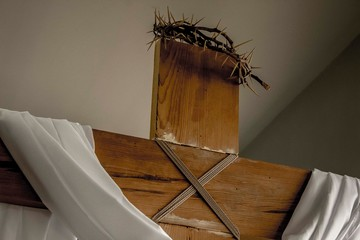Low Angle View Of Wooden Cross With Spiked Crown Against Ceiling