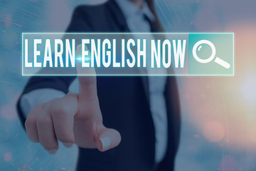 Writing note showing Learn English Now. Business concept for gain or acquire knowledge and skill of...