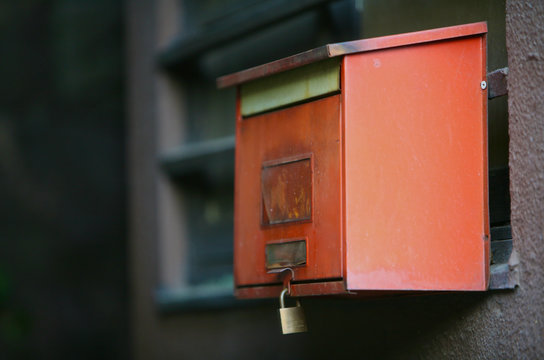 Locked Mail Box Mounted On Wall