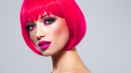 Poster Kapsalon Caucasian fashion model with bob hairstyle colored in pink. Female Eyes with vivid makeup.