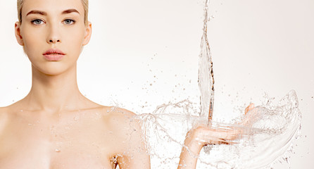 Printed kitchen splashbacks Spa Photo of young woman with falling water into her palms. Young woman with clean skin and splash of water. Spa treatment. Skin and body care. Hygiene body concept. Human and water.