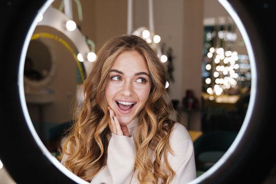 Cheery blonde girl indoors in beauty salon