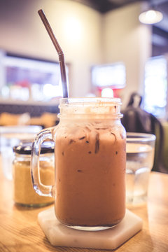 Close-up Of Drink In Mason Jar Served On Table In Restaurant