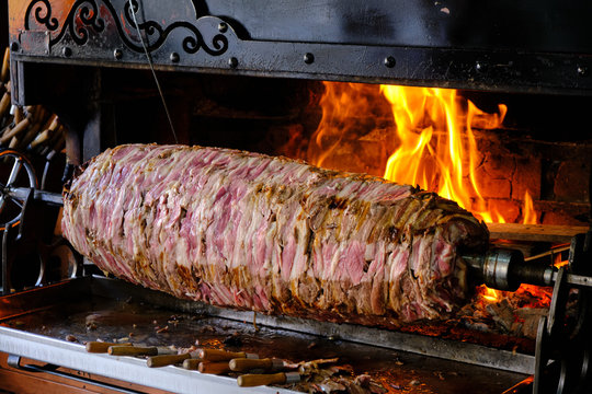 https stock adobe com images cag kebap traditional turkish kebap being prepared by chef slicing kebab to serve 338360870 start checkout 1 content id 338360870