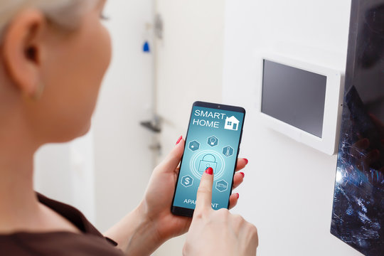 Smart home keyboard password entrance. Human hand pressing the security code combination to unlock the door. staff pushes a button of access control system to unlock doors. selective focus.