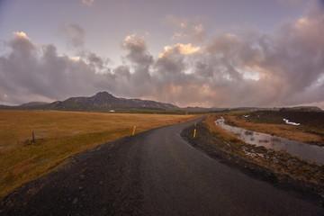 Foto auf AluDibond Lavendel Empty Road Along Countryside Landscape