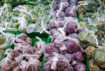 Vegetables displayed in shopping bags to prevent coronavirus spread on supermarket racks