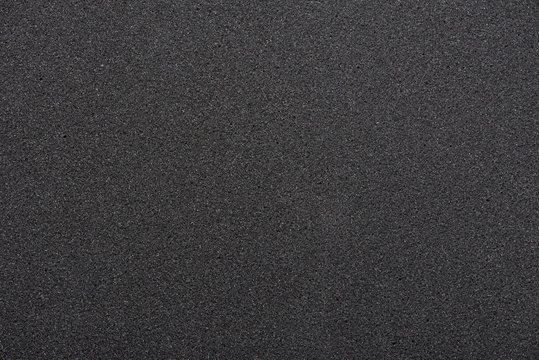 Black sponge texture. foam rubber background