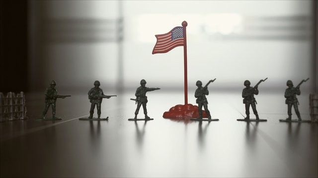 Figures of soldiers. Silhouette Of A Soldier Against Us Flag Background