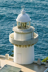 Obraz A lighthouse at Donostia-San Sebastian, Basque region of Spain, the Queen of Euskadi's and Cantabrian Coast, as seen from Monte Igueldo overlook view spot - fototapety do salonu