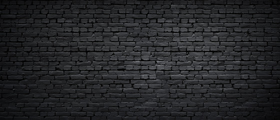 Poster Retro Texture of a black painted brick wall as a background or wallpaper