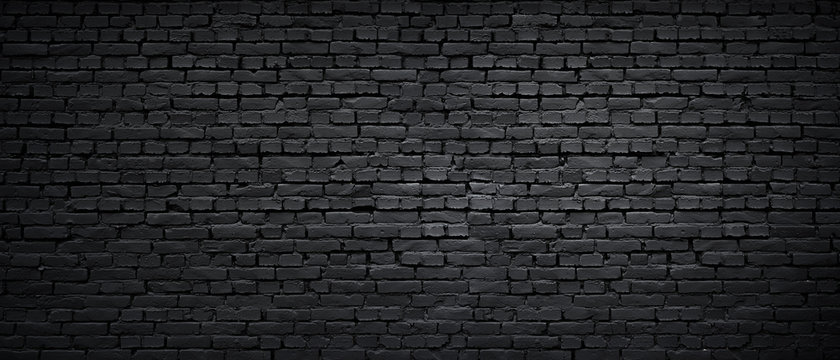 Texture of a black painted brick wall as a background or wallpaper