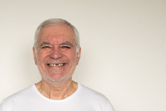 not in focus old man senior face closeup missing tooth smile proper tooth overexposed