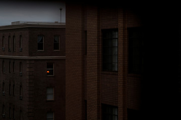 A lamp is illuminated inside of an apartment in the Dupont Circle neighborhood following Mayor Muriel Bowser's declaration of a state of emergency due to the coronavirus in Washington