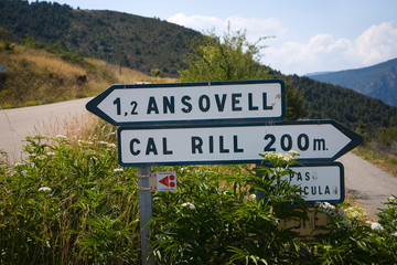 Wall Mural - Road signs to Ansovell and Cal Rill Medieval villages in Pyrenees Mountains, near La Seu d'Urgell, Cataluna, province of Lleida, off N-260 Road, Spain, Europe