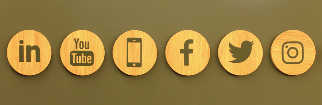 Set of popular social media wooden icons on the wall