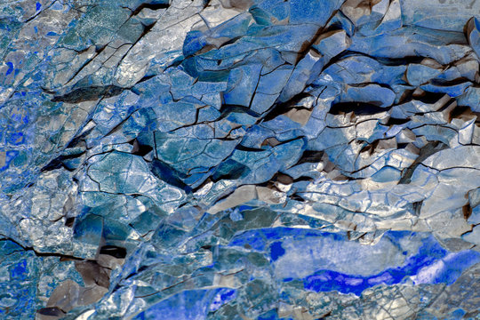 Turquoise and blue natural stone texture. Sedimentary rock is unique for every natural compound - all kinds of faults, cracks, faults, folds. Different colors and unique pattern.