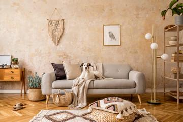 Stylish scandi compostion at living room interior with design sofa, commode, shelf, carpet, rattan...