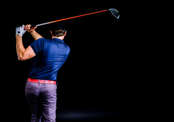 Close-up of a golf player intent on perfecting the swing