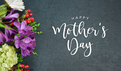 Wall Murals London Happy Mother's Day Calligraphy Text with Beautiful Flowers Bouquet and Black Texture Background