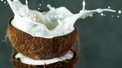 Wall Mural - Super Slow Motion Shot of Water Splashing on Coconut at 4K.
