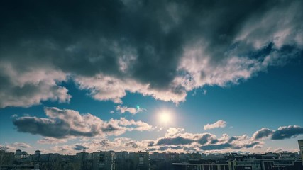Fotobehang - Dramatic clouds moving over sunset sun and blue sky background. Timelapse, 4K UHD.