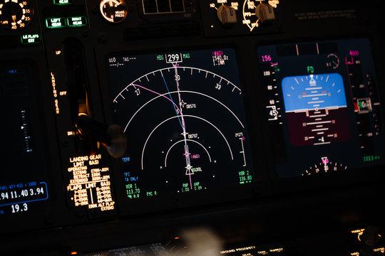 Display navigator system of Boeing aircraft. Automatic landing system. Night shot inside cabin. ILS