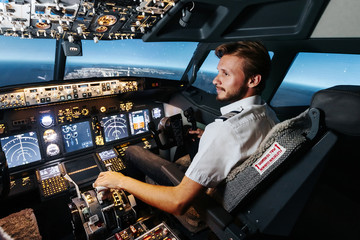 Fototapeta First officer is controlling autopilot and parameters for safety flight. Cockpit of Boeing aircraft. Content is good any airline. obraz