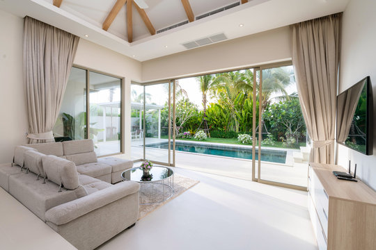 Interior and exterior design of living room with pool view in villa, house, home, condo and apartment