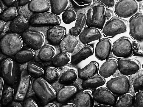 Close-up Of Pebbles In Water