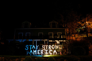 Sign seen lit outside house during outbreak of coronavirus disease (COVID-19) in New York City suburb of Piermont