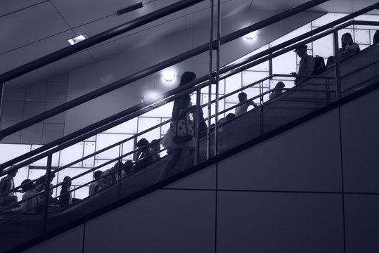 People On Escalator In Shopping Mall