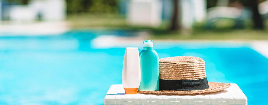 Suncream bottles, goggles, starfish on the edge of the pool
