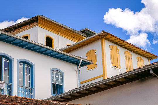 Close up of upper storeys of typical colonial buildings in the historical town of Serro, Minas Gerais Brazil