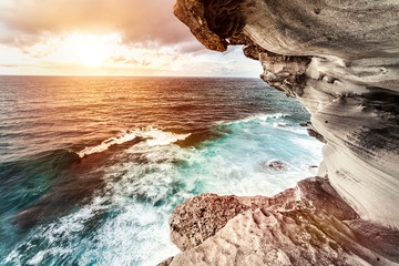 Wonderful sunset over the sea with waves. Amazing view from the rocky coast at Bondi Beach in Sydney Australia. Fototapete