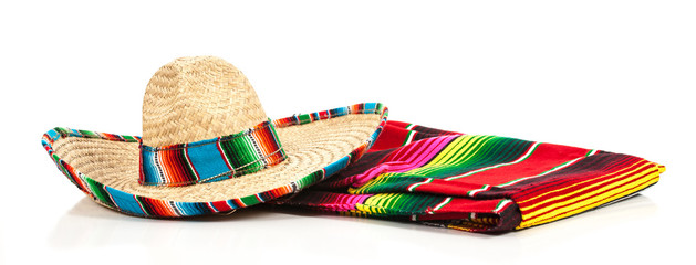 A woven Mexican sombrero or hat with a colorful serape blanket